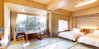 畳敷きにベッドを備えたツインルーム