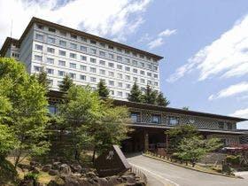 妊婦の妻を連れて北湯沢温泉に行きます。ベッドの方が良いとのことなのでベッドのある宿を教えてください。